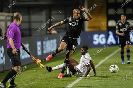 Farense`s Abner (2R) fights for the ball with Sporting`s Joao Mario (2L) during their Portuguese First League soccer match held at Farense Stadium, Faro, Portugal, 16 April 2021.