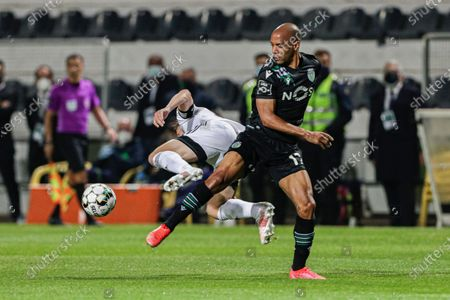 Farense's Ryan Gauld (L) fights for the ball with Sporting's Joao Mario during their Portuguese First League soccer match in Faro, Portugal, 16 April 2021.