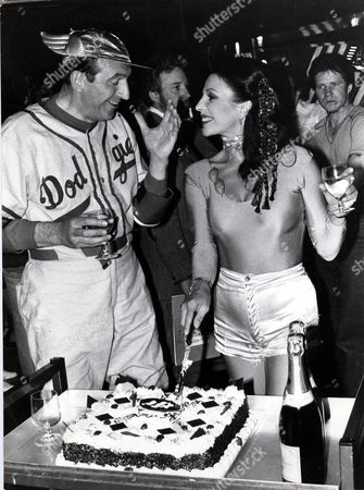 Joan Collins On The Cinzano Set With Leonard Rossiter And A Cake