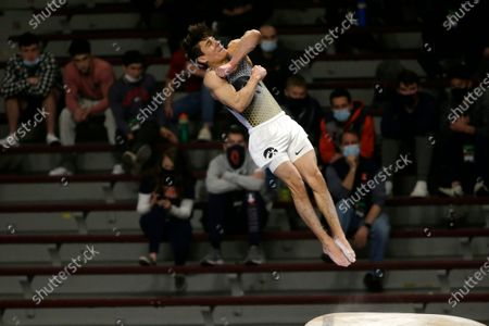 Stock Picture of Iowa's Evan Davis competes on the vault during the NCAA men's gymnastics championships, in Minneapolis