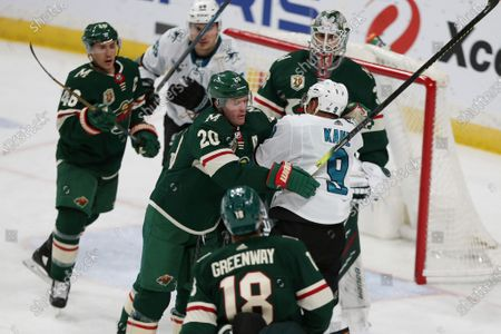 Minnesota Wild's Ryan Suter (20) argues with San Jose's Evander Kane (9) during the third period of an NHL hockey game, in St. Paul, Minn. Minnesota won 3-2