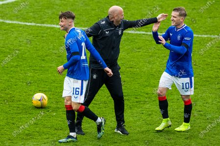 Nathan Patterson of Rangers celebrates at the end with Assistant Manager Gary McAllister and Steven Davis at the Scottish Cup match at Ibrox Stadium, Glasgow.