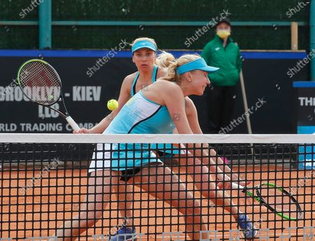 Ukrainian players Nadiia Kichenok (front) and Lyudmyla Kichenok (back) in action against Japanese players Shiho Akita and Himari Sato during their doubles match of the Billie Jean King Cup playoff tie between Ukraine and Japan at the Elite Tennis Club in Chornomorsk, Ukraine, 17 April 2021.