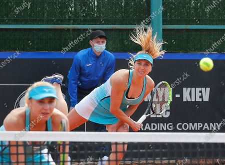 Ukrainian players Nadiia Kichenok (L) and Lyudmyla Kichenok (R) in action against Japanese players Shiho Akita and Himari Sato during their doubles match of the Billie Jean King Cup playoff tie between Ukraine and Japan at the Elite Tennis Club in Chornomorsk, Ukraine, 17 April 2021.