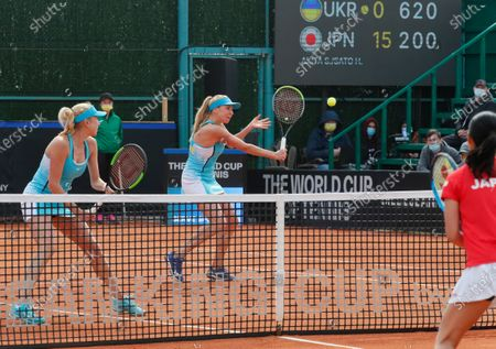Ukrainian players Nadiia Kichenok (C) and Lyudmyla Kichenok (L) in action against Japanese players Shiho Akita and Himari Sato during their doubles match of the Billie Jean King Cup playoff tie between Ukraine and Japan at the Elite Tennis Club in Chornomorsk, Ukraine, 17 April 2021.