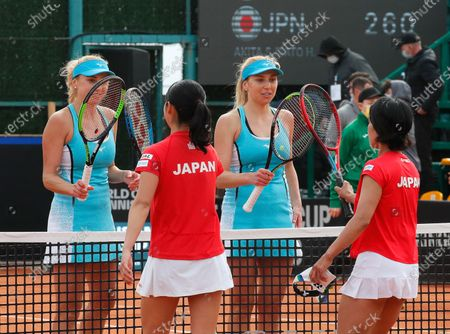 Ukrainian players Nadiia Kichenok (L) and Lyudmyla Kichenok (2-R) greet Japanese players Shiho Akita (R) and Himari Sato (2-L) after their doubles match of the Billie Jean King Cup playoff tie between Ukraine and Japan at the Elite Tennis Club in Chornomorsk, Ukraine, 17 April 2021.