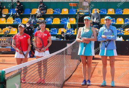 Stock Image of Japanese players Shiho Akita (L) and Himari Sato (2-L) and Ukrainian players Nadiia Kichenok (2-R) and Lyudmyla Kichenok (R) pose for photographers before their doubles match of the Billie Jean King Cup playoff tie between Ukraine and Japan at the Elite Tennis Club in Chornomorsk, Ukraine, 17 April 2021.