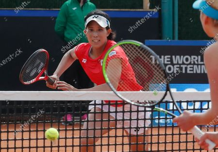 Shiho Akita (L) of Japan in action with her teammate Himari Sato against Ukrainian players Nadiia Kichenok and Lyudmyla Kichenok during their doubles match of the Billie Jean King Cup playoff tie between Ukraine and Japan at the Elite Tennis Club in Chornomorsk, Ukraine, 17 April 2021.