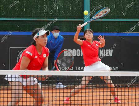 Japanese players Shiho Akita (L) and Himari Sato (R) in action against against Ukrainian players Nadiia Kichenok and Lyudmyla Kichenok during their doubles match of the Billie Jean King Cup playoff tie between Ukraine and Japan at the Elite Tennis Club in Chornomorsk, Ukraine, 17 April 2021.