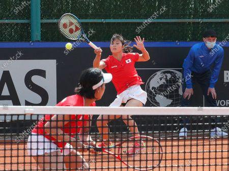 Japanese players Shiho Akita (L) and Himari Sato (C) in action against against Ukrainian players Nadiia Kichenok and Lyudmyla Kichenok during their doubles match of the Billie Jean King Cup playoff tie between Ukraine and Japan at the Elite Tennis Club in Chornomorsk, Ukraine, 17 April 2021.