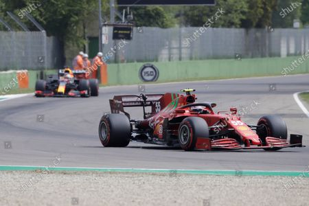 Ferrari driver Carlos Sainz of Spain is chased by Red Bull driver Max Verstappen of the Netherlands during free practice for Sunday's Emilia Romagna Formula One Grand Prix, at the Imola track, Italy