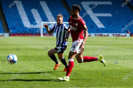 Zak Vyner of Bristol City is challenged by Jordan Rhodes of Sheffield Wednesday