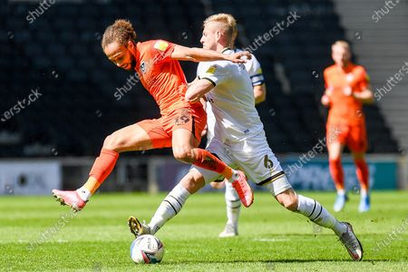 Stock Picture of Portsmouth FC midfielder Marcus Harness (19) battles for possession with Milton Keynes Dons defender Harry Darling (6) during the EFL Sky Bet League 1 match between Milton Keynes Dons and Portsmouth at stadium:mk, Milton Keynes