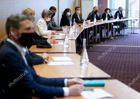 Stock Picture of Former EELV's spokeswoman Sandrine Rousseau (CL), EELV Green Party European deputy Yannick Jadot (C), Paris Mayor Anne Hidalgo (CR) attend a meeting of left-wing leaders for the 2022 presidential elections, in Paris, France, 17 April 2021.