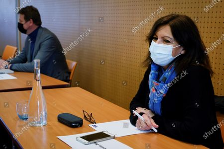 Stock Image of Paris Mayor Anne Hidalgo (R) and EELV Green Party European deputy Yannick Jadot attend a meeting of left-wing leaders for the 2022 presidential elections, in Paris, France, 17 April 2021.