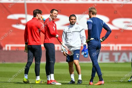 (LtoR) Sol Brynn (#31) and Marcus Bettinelli (#1) of Middlesbrough FC speak with QPR assistant goalkeeping coach Erbil Bozkurt and Joe Lumley (#1) of Queens Park Rangers FC during the warm up before the EFL Sky Bet Championship match between Middlesbrough and Queens Park Rangers at the Riverside Stadium, Middlesbrough