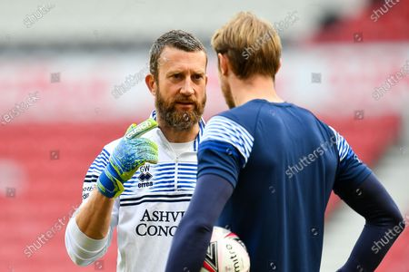 Queens Park Rangers goalkeeping coach, Gavin Ward speaks with Joe Lumley (#1) of Queens Park Rangers FC during the warm up before the EFL Sky Bet Championship match between Middlesbrough and Queens Park Rangers at the Riverside Stadium, Middlesbrough