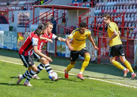 Southend United Louis Walsh (32) on the ball and under pressure from Archie Collins (10) of Exeter City and Randell Williams (11) of Exeter City  during the EFL Sky Bet League 2 match between Exeter City and Southend United at St James' Park, Exeter