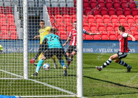Southend United Louis Walsh (32) attacking the goal and is under pressure from Lewis Page (20) of Exeter City   during the EFL Sky Bet League 2 match between Exeter City and Southend United at St James' Park, Exeter