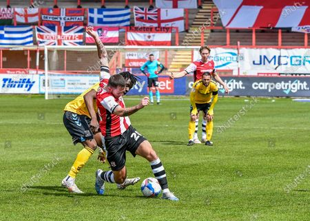 Lewis Page (20) of Exeter City shields the ball and battles for the ball  during the EFL Sky Bet League 2 match between Exeter City and Southend United at St James' Park, Exeter