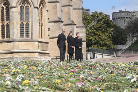 (left to right) The Prince Edward, Lady Louise Windsor and Sophie Countess of Wessex view flowers outside St George's Chapel, at Windsor Castle, Berkshire, following the death of the Duke of Edinburgh at the age of 99 on April 9.