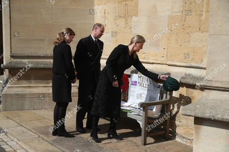 (left to right) Lady Louise Windsor, The Prince Edward and Sophie Countess of Wessex view tributes outside St George's Chapel, at Windsor Castle, Berkshire, following the death of the Duke of Edinburgh at the age of 99 on April 9.