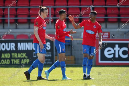 George Saunders of Dagenham scores the first goal for his team and celebrates with his team mates during Dagenham & Redbridge vs Solihull Moors, Vanarama National League Football at the Chigwell Construction Stadium on 17th April 2021