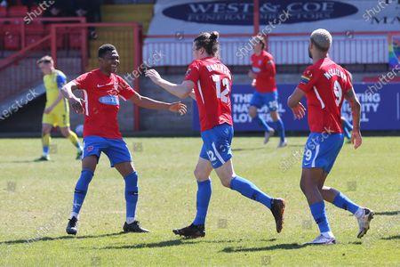 Matt Robinson of Dagenham (12) scores the third goal for his team and celebrates during Dagenham & Redbridge vs Solihull Moors, Vanarama National League Football at the Chigwell Construction Stadium on 17th April 2021