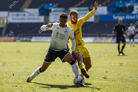 Swansea City forward Morgan Whittaker (17) and Wycombe Wanderers midfielder Curtis Thompson (18) during the EFL Sky Bet Championship match between Swansea City and Wycombe Wanderers at the Liberty Stadium, Swansea