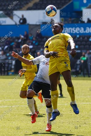 Wycombe Wanderers defender Anthony Stewart (5) heads the ball during the EFL Sky Bet Championship match between Swansea City and Wycombe Wanderers at the Liberty Stadium, Swansea