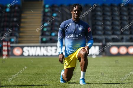 Stock Picture of Wycombe Wanderers defender Anthony Stewart (5) warms up ahead of the EFL Sky Bet Championship match between Swansea City and Wycombe Wanderers at the Liberty Stadium, Swansea