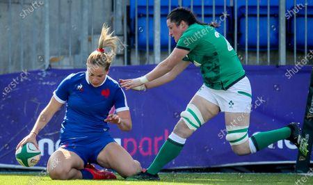 Stock Photo of Ireland Women vs France Women. France's Romane Menager scores a try despite Hannah O'Connor of Ireland
