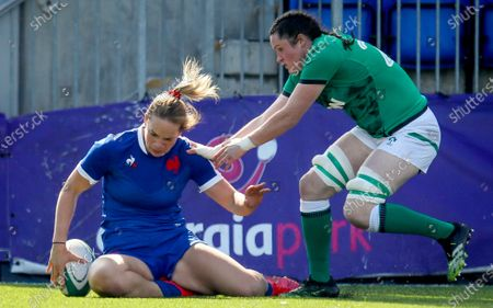 Stock Picture of Ireland Women vs France Women. France's Romane Menager scores a try despite Hannah O'Connor of Ireland