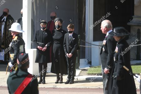 (Left to right) Lady Louise Windsor, Sophie Countess of Wessex and James Viscount Severn watching the procession, as Prince Charles and Princess Anne walk past, at the Galilee Porch of St George's Chapel, Windsor Castle, Berkshire, during the funeral of Prince Philip