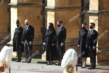 (Left to right) Zara Tindall, Mike Tindall, Princess Eugenie, Jack Brooksbank, Princess Beatrice and Edoardo Mapelli Mozzi watching the procession at the Galilee Porch of St George's Chapel, Windsor Castle, Berkshire, during the funeral of the Duke of Edinburgh