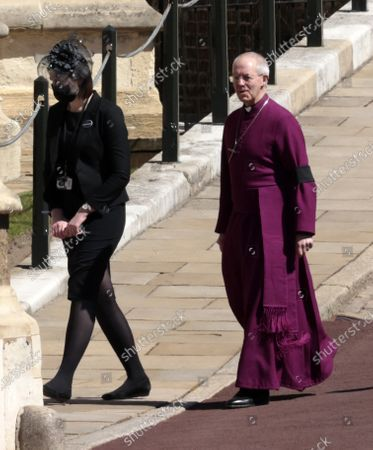 Archbishop of Canterbury Justin Welby, right, arrives at the Windsor Castle ahead of the funeral of Britain's Prince Philip in Windsor, England, . Prince Philip died April 9 at the age of 99 after 73 years of marriage to Britain's Queen Elizabeth II