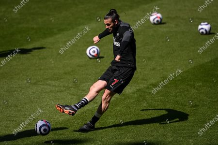 Stock Photo of Andy Carroll of Newcastle warms up ahead of the English Premier League soccer match between Newcastle United and West Ham United in Newcastle, Britain, 17 April 2021.