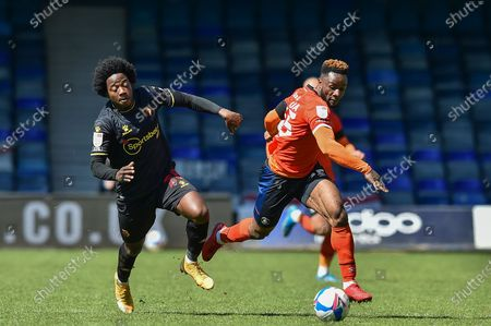 Luton Town forward Kazenga LuaLua (25) runs with the ball challenged by Watford's Carlos Sanchez (28) during the EFL Sky Bet Championship match between Luton Town and Watford at Kenilworth Road, Luton