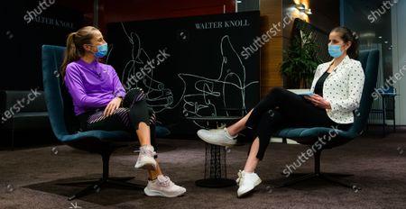 Belinda Bencic of Switzerland & Julia Goerges of Germany at the 2021 Porsche Tennis Grand Prix WTA 500 tournament