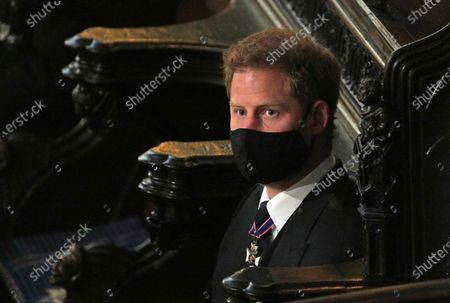 Stock Picture of Prince Harry sits alone at St. George's Chapel during the funeral for Prince Philip, at Windsor Castle, Windsor, England, . Prince Philip died April 9 at the age of 99 after 73 years of marriage to Britain's Queen Elizabeth II