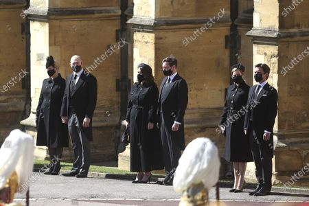 From left, Zara Tindall, Mike Tindall, Princess Eugenie, Jack Brooksbank, Princess Beatrice and Edoardo Mapelli Mozzi watch the procession at the Galilee Porch of St George's Chapel, Windsor Castle, Windsor, England, during the funeral of Britain's Prince Philip. Prince Philip died April 9 at the age of 99 after 73 years of marriage to Britain's Queen Elizabeth II