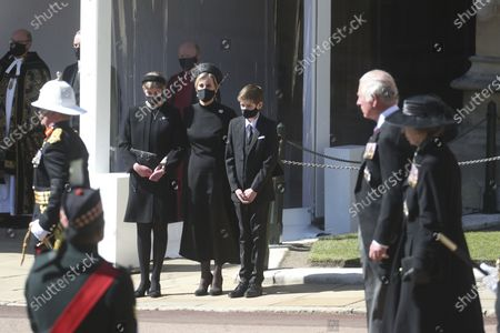 Sophie, the Countess of Wessex, center, Lady Louise Windsor, and James, Viscount Severn watch the procession, as Prince Charles and Princess Anne walk past, from the Galilee Porch of St George's Chapel, Windsor Castle, Windsor, England, during the funeral of Britain's Prince Philip. Prince Philip died April 9 at the age of 99 after 73 years of marriage to Britain's Queen Elizabeth II
