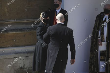 Zara and Mike Tindall arrive at the Galilee Porch of St George's Chapel, Windsor Castle, Windsor, England, for the funeral of Britain's Prince Philip. Prince Philip died April 9 at the age of 99 after 73 years of marriage to Britain's Queen Elizabeth II