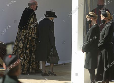 Queen Elizabeth II at the Galilee Porch of St George's Chapel with The Dean of Windsor as Sophie, Countess of Wessex, right, and Lady Louise Windsor look, at Windsor Castle, Windsor, England, during the funeral of Britain's Prince Philip. Prince Philip died April 9 at the age of 99 after 73 years of marriage to Britain's Queen Elizabeth II