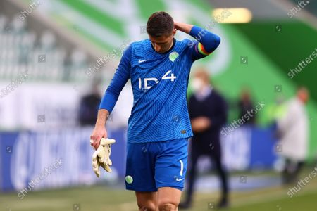 Koen Casteels of VfL Wolfsburg looks dejected following his team's defeat in the German Bundesliga soccer match between VfL Wolfsburg and FC Bayern Munich at Volkswagen Arena in Wolfsburg, Germany, 17 April 2021.
