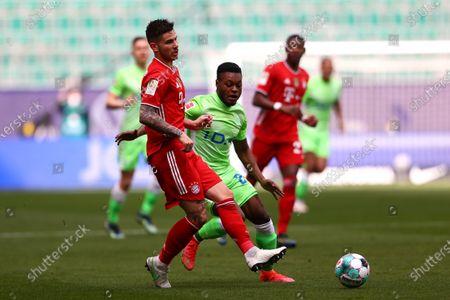 Lucas Hernandez (L) of FC Bayern Muenchen is challenged by Ridle Baku of VfL Wolfsburg during the Bundesliga match between VfL Wolfsburg and FC Bayern Munich at Volkswagen Arena in Wolfsburg, Germany, 17 April 2021.