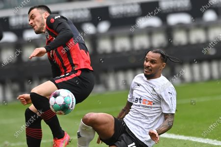 Frankfurt's Filip Kostic (L) in action against Moenchengladbach's Valentino Lazaro (R) during the German Bundesliga soccer match between Borussia Moenchengladbach and Eintracht Frankfurt in Moenchengladbach, Germany, 17 April 2021.