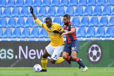 Crotone's Koffi Djidji (R) and Udinese's Stefano Okaka in action during the Italian Serie A soccer match between FC Crotone and Udinese Calcio at Ezio Scida stadium in Crotone, Italy, 17 april 2021.