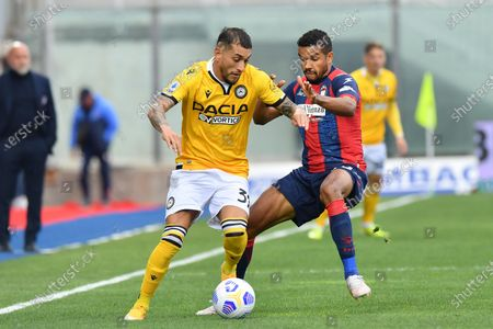 Udinese's midfielder Roberto Pereyra (L) and Crotone's forward Junior Messias in action during the Italian Serie A soccer match between FC Crotone and Udinese Calcio at Ezio Scida stadium in Crotone, Italy, 17 april 2021.
