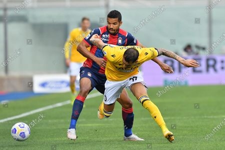Udinese's midfielder Roberto Pereyra (front) and Crotone's forward Junior Messias in action during the Italian Serie A soccer match between FC Crotone and Udinese Calcio at Ezio Scida stadium in Crotone, Italy, 17 april 2021.